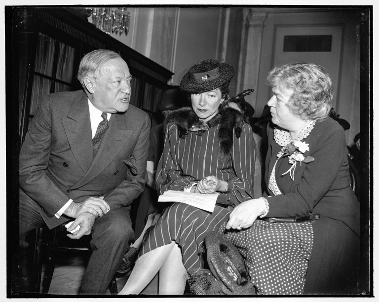 "Actress Helen Hayes flanked by Senator Robert F. Wagner (New York) and Representative Edith Nourse Rogers (Massachusetts) before the US Senate subcommittee on immigration, April 20, 1939 Democrat Wagner and Republican Rogers introduce a bill to allow 20,000 refugee children to enter the United States above the annual quota for German immigrants. They are supported by celebrities such as actress Helen Hayes, who speaks on behalf of the bill before the Senate subcommittee on immigration ""as an American mother."" The initiative fails, however, due to strong opposition to it and a lack of support from the Roosevelt administration. Harris & Ewing / Library of Congress, Washington, DC, Prints & Photographs Division, LC-H22-D- 6377"