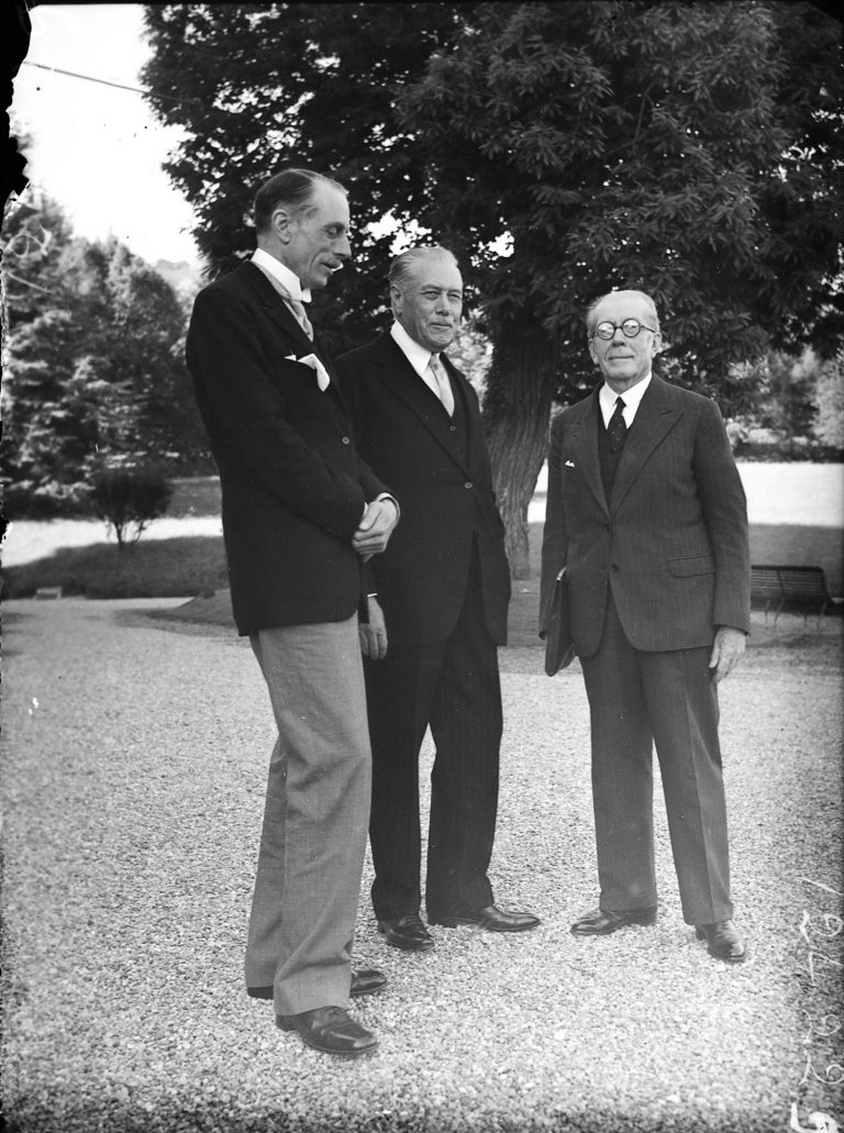 Lord Winterton, Myron C. Taylor and Senator Bérenger in the Hotel Royal park, July 6, 1938  On July 6, 1938 it remains unclear who will chair the conference. The French turn down the chairmanship because the conference has been initiated by US president Roosevelt. At the last minute it is agreed that Henry Bérenger of France will open and close the conference as honorary president, and Myron C. Taylor will chair the working sessions as conference president. National Archives, College Park, MD