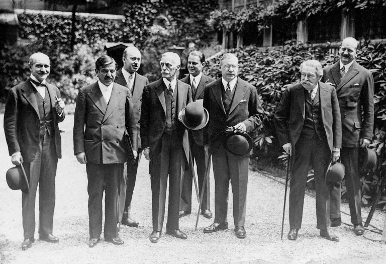 Pell (5th from left) with French Budget Minister François Pietri, French Prime Minister Pierre Laval, US Treasury Secretary Andrew W. Mellon, US Ambassador to France Walter E. Edge, French Foreign Minister Aristide Briand and French Finance Minister Étienne Flandin, July 1931 Robert T. Pell participates in the 1931 Paris Conference on the solution of the German financial crisis, as press liaison officer from the US Embassy in France. SZ Photo, München