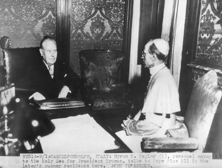 "Myron C. Taylor and Pope Pius XII at the Vatican, September 5, 1947 In December 1939, Taylor is sent to Rome as Roosevelt's ""personal envoy"" to Pope Pius XII. His first task is to stop Italy from entering the war alongside Germany, and then to convince the Pope of the eventual victory of the Allies and persuade him to protest against the persecution of the Jews. Bettmann Archive / Getty Images"
