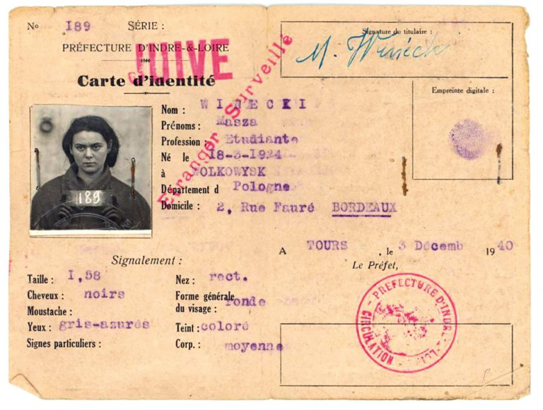 "Identity card of Masza Winecki, stamped ""Jew"" and ""foreigner under surveillance"" On October 4, 1940, the Vichy government enacts a law allowing prefects, or regional governors, to immediately detain foreigners of the ""Jewish race."" Under this edict, the Polish-born schoolgirl Masza Winecki and her family are deported to the La Lande internment camp in Monts in 1941, and from there to Auschwitz via Drancy in 1942. Archives départementales d'Indre et Loire, Tours"