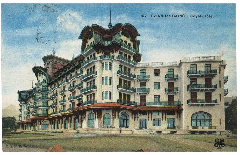 "Picture postcard of the Hotel Royal in Évian-les-Bains, around 1927 The Hotel Royal, which opens in 1909, is planned by the Société des Eaux Minérales d'Évian as ""Europe's most beautiful hotel."" Built in the British-Norman style, it is named for the British king Edward VII. A suite is always reserved for him there, but he dies in 1910 without ever setting foot in it. Still, the Hotel Royal soon becomes the preferred residence for members of the European aristocracy, Middle Eastern potentates and writers like Marcel Proust, who is said to have written par ts of ""Remembrance of Things Past"" there. Edit. M. Hoffmann / Maurice Tesson Imprimeur Limoges"