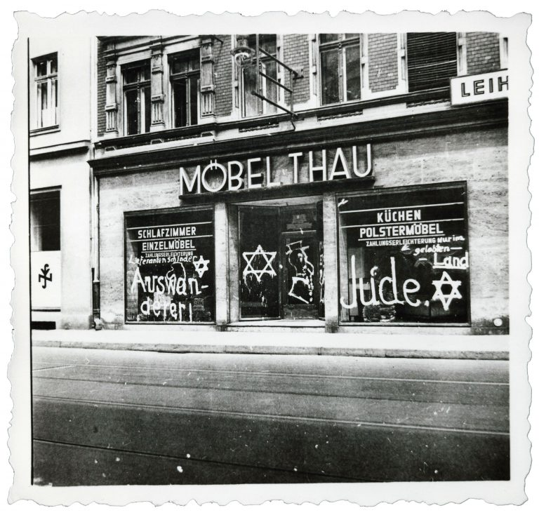 """The furniture store Thau vandalized with antisemitic graffiti, Berlin, June 19, 1938 Jewish businesses are defined legally for the first time in the """"Third Ordinance to the Reich Citizens Act"""" of June 14, 1938. A few days after the law's passage, Berlin sees a pogrom that in hindsight can be interpreted as a kind of dress rehearsal for the events of November 1938: Jewish-owned shops across the city are vandalized with graffiti, and some are looted. Centrum Judaicum, Berlin"""