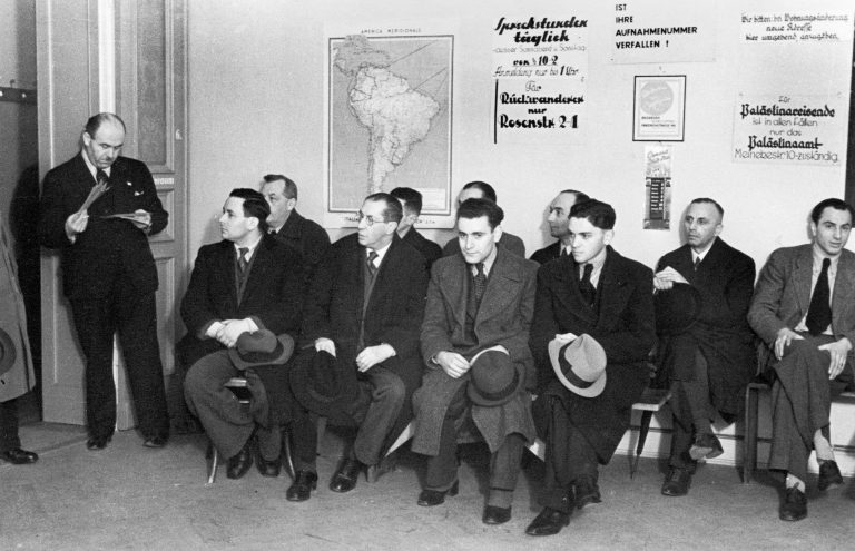 The waiting room of the Jewish aid association's emigration counseling office, undated  The Hilfsverein der deutschen Juden (Aid Association of German Jews) is founded in Berlin in 1901 to support Jews from Eastern Europe. Between 1901 and 1913, it helps 200,000 Russian Jews emigrate overseas. After 1933, when Jews are no longer considered German under the Nazis, the association is forced to change its name to Hilfsverein der Juden in Deutschland (Aid Association of Jews in Germany). By 1941 it has helped some 90,000 German Jews emigrate overseas. Photo: Abraham Pisarek / bpk 30045701