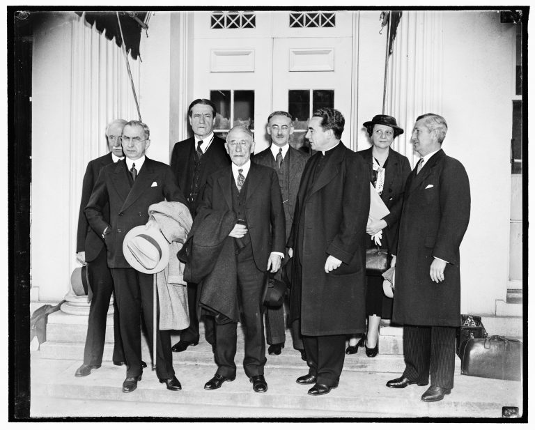 Members of the President's Advisory Committee on Refugees in front of the White House, April 13,1938  l. to r.: New York legal scholar Joseph P. Chamberlain; Assistant Secretary of State George S. Messersmith; Rabbi Stephen S. Wise, President of the World Jewish Congress; Henry Morgenthau, sr.; New York Protestant Bishop Samuel M. Cavert; Monsignor Michael J. Ready; Secretary of Labor Frances Perkins; and Louis P. Kenedy, President of the National Council of Catholic Men, after their first meeting with President Roosevelt. The Advisory Committee is chaired by James G. McDonald, former League of Nations High Commissioner for Refugees. Harris & Ewing / Library of Congress, Washington DC, Prints & Photographs Division, LC-DIG-hec-24424