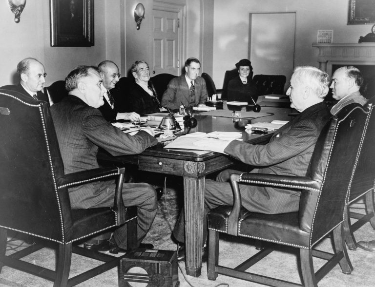 Emergency meeting of Roosevelt's cabinet, 1938 The photo shows President Franklin D. Roosevelt (2nd from left) with (clockwise) Secretary of the Treasury Henry Morgenthau, Attorney General Homer Cummings, Secretary of the Navy Claude A. Swanson, Secretary of Agriculture Henry A. Wallace, Secretary of Labor Frances Perkins, Secretary of War Harry Woodring and Secretary of State Cordell Hull. Bettmann Archive / Getty Images